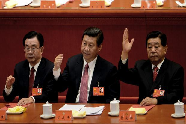 Chinese vice president Xi Jinping, centre, with communist leaders at the closing of the 18th Communist Party Congress at the Great Hall of the People in Beijing on Wednesday. Photo: Goh Chai Hin/AFP