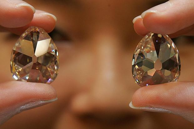 The diamond was the star lot at Christie's semi-annual jewellery sale in Geneva, which fetched 76.6 million francs, with 290 of 348 lots sold. Photo: Mike Clarke/AFP