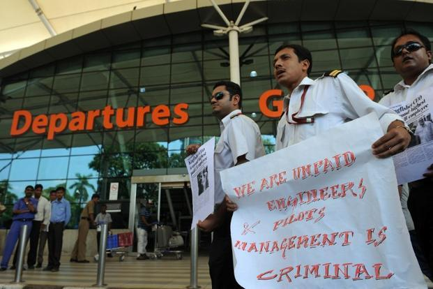 A file photo of Kingfisher employees at the Mumbai airport. Photo: AFP