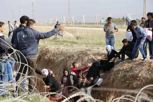 Thousands of Syrians fled their country on Friday in one of the biggest refugee exoduses of the 20-month civil war after rebels seized a border town, and the UN warned that millions more still in Syria will need help as winter sets in. Photo: Murad Sezer/Reuters