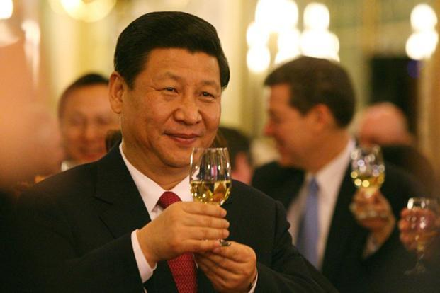 Xi shares a toast during a state dinner at the Iowa State Capitol on 15 February 2012. Xi's working style has been summed up in his own words as 'Do it now'. AFP