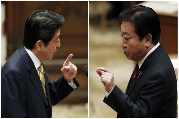 Japanese Prime Minister Yoshihiko Noda, right, and main opposition Liberal Democratic Party (LDP) leader Shinzo Abe at a parliamentary debate in Tokyo on Wednesday. Photo: Kim Kyung-Hoon/Reuters