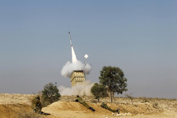 Israeli soldiers watch as an Iron Dome launcher fires an interceptor rocket near the southern city of Beersheba on Thursday. The interceptor system has so far shot down more than 80 rockets headed for residential areas. Photo: Baz Ratner/Reuters