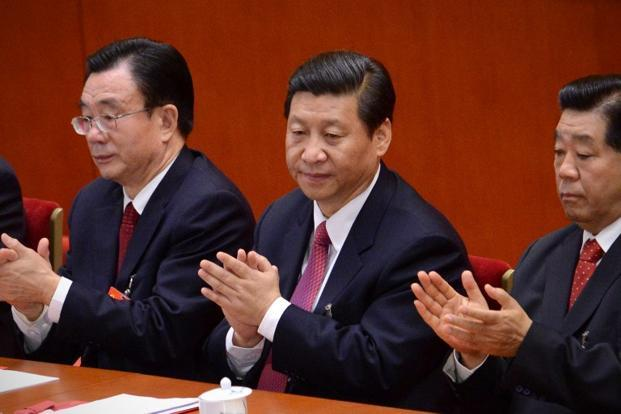 Xi Jinping (centre) applauds during the closing of the 18th Communist Party Congress at the Great Hall of the People in Beijing on Wednesday. Photo: Wang Zhao/AFP