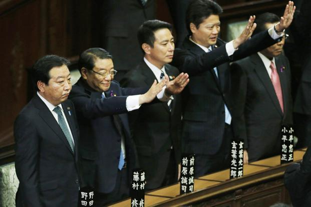Japan's Prime Minister Yoshihiko Noda, left, with his cabinet ministers after the dissolution of the lower house was announced at the Parliament in Tokyo on Friday. Photo: Kim Kyung-Hoon/Reuters