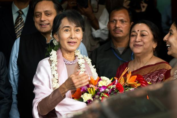 Nobel Peace Laureate and Myanmar's pro-democracy leader Aung San Suu Kyi (centre) along with Shashi Tharoor (left) and principal of Lady Sri Ram College Meenakshi Gopinath (right) during her visit to the college in New Delhi on Friday. Photo: AFP