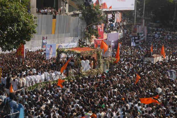 Bal Thackeray's followers join the funeral procession of the Shiv Sena supremo from his residence to Shivaji Park in Mumbai on Sunday. Photo: Hemant Mishra/Mint