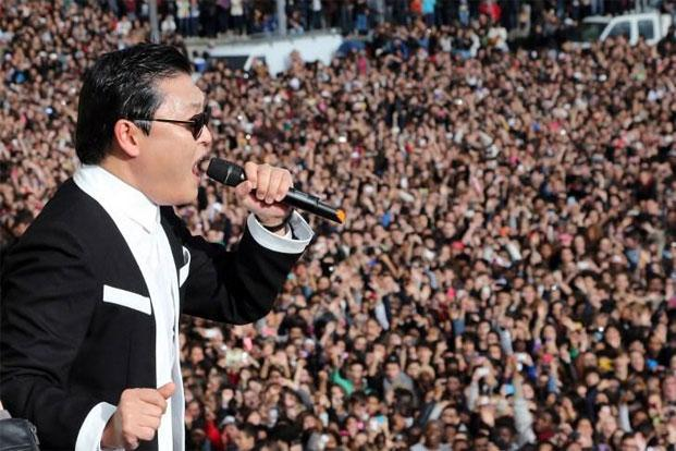 "South Korean rapper Psy performs ""Gangnam Style"" in front of a crowd during a flashmob in Paris. Thomas Samson/AFP"