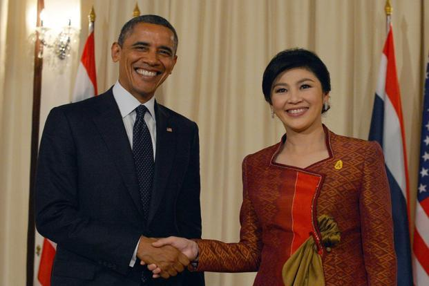 US President Barack Obama (left) and Thai Prime Minister Yingluck Shinawatra shake hands before a bilateral meeting at the Thai Government House in Bangkok on Sunday. Photo: Jewel Samad/AFP