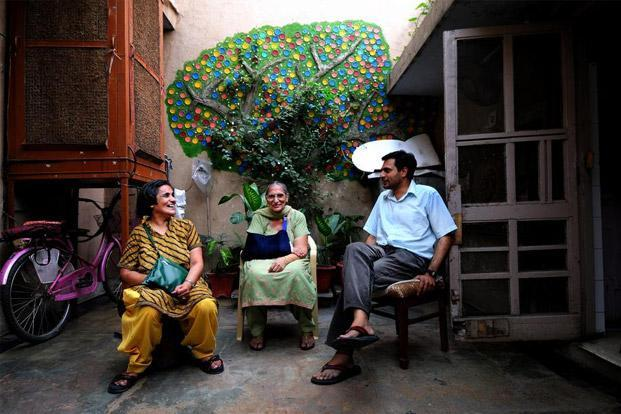 Indira Gulati (centre) with son Ravi and daughter Sonia in her first-floor apartment in Khan Market. Photo: Pradeep Gaur/Mint
