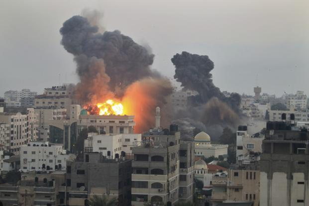 Smoke and fire following explosions after the Israeli air strikes in Gaza City on 19 November. Reuters