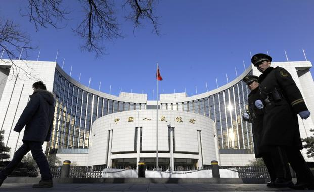 A file photo of the headquarters of the People's Bank of China in Beijing. Photo: AFP
