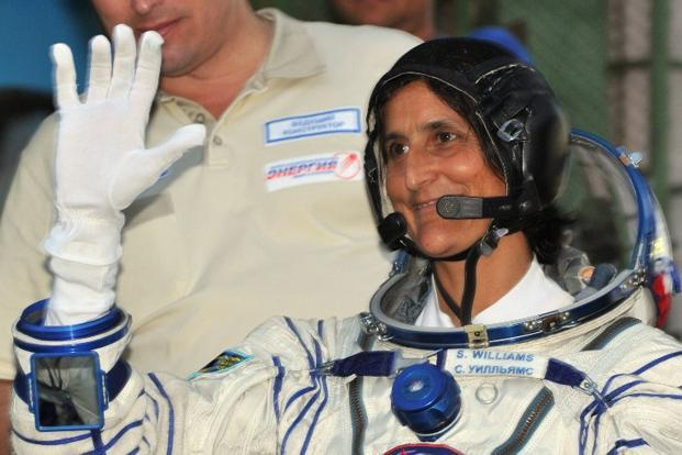A file photo of astronaut Sunita Williams gesturing before boarding the Soyuz TMA-05M spacecraft at the Russian-leased Baikonur cosmodrome on 15 July. Photo: Vyacheslav Oseledko/AFP