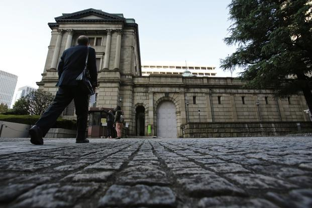 A man walks towards the Bank of Japan headquarters building in Tokyo. Photo: Yuriko Nakao/Reuters