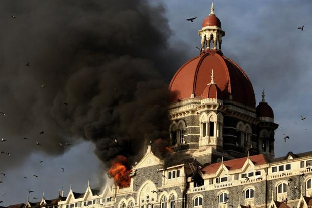 Flames and smoke gush out of the Taj Mahal Hotel in Mumbai on 27 November 2008, after it was attacked by terrorists including Kasab. 166 people were killed and around 100 more wounded in the ensuing masacre. AFP