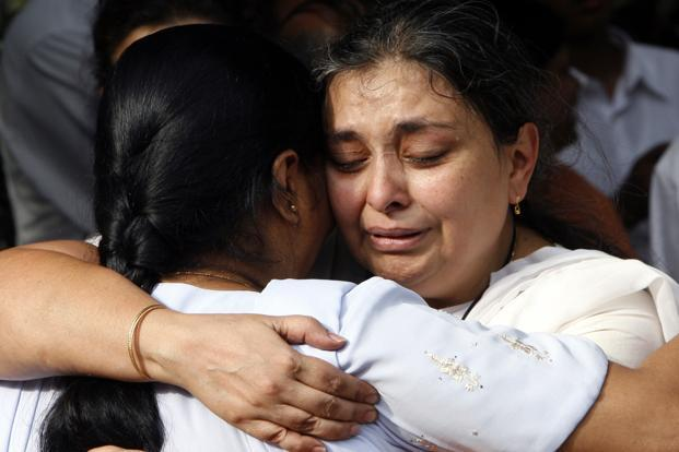 Farida (right) is comforted by unidentified person after the funeral of her husband Vijay Rao Bhanja in Mumbai on 29 November 2008. Bhanja, executive chef at the Taj Hotel, was killed by the terrorists including Kasab. Reuters
