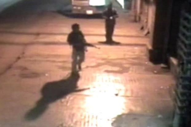 Closed circuit television footage released on 3 December 2008 shows terrorists walking across a parking lot after the shooting spree at the Chhatrapati Shivaji Terminus train station in Mumbai on 26 November. Reuters