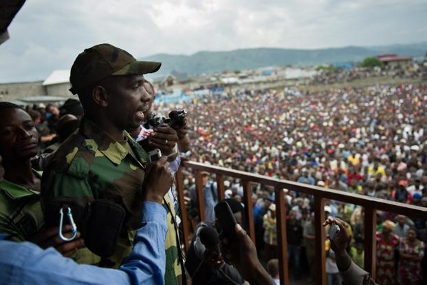 Spokesman of the M23 rebel group Vianney Kazarama addresses a crowd at the Volcanoes Stadium in Goma. Photo: AFP