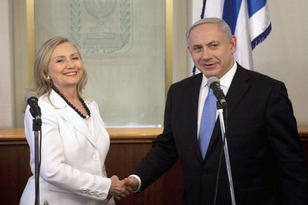 A file photo of US secretary of state Hillary Clinton (left) with Israeli Prime Minister Benjamin Netanyahu. Photo: Abir Sultan/AFP