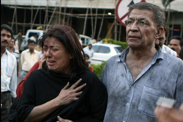 Two foreign nationals who were held hostage by the terrorists for nearly twenty four hours walk together following their release from the Trident Oberoi hotel in Mumbai on 27 November, 2008. AFP
