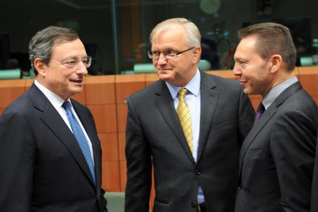 European Central Bank president Mario Draghi (left) speaks with EU commissioner for Economic and Monetary Affairs Olli Rehn (centre), and Greek finance minister Ioannis Stournaras (right), before a euro zone finance ministers meeting on Tuesday. Photo: AFP