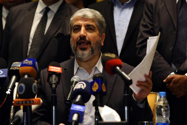 "Hamas' leader in exile Khaled Meshaal said in a news conference if Israel complied with a ceasefire in the Gaza conflict, Palestinians would do the same but his fighters' ""hands were on the trigger"" should there be any violations. Photo: Mohamed Abd El Ghany/Reuters"