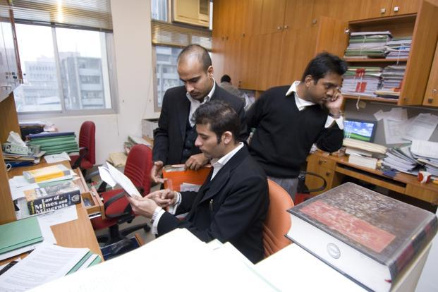 A file photo of lawyers at a law firm in New Delhi. The research paints a psychological picture of why lawyers leave. Photo: Mint