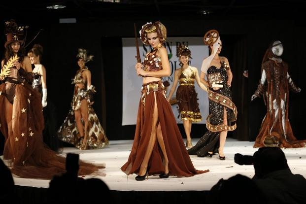 Models present dresses made of chocolate during a fashion show for the inauguration of Cannes international chocolate fair. AFP