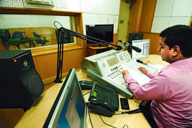 Newsreader Divyanand Jha poses for Lounge in the AIR studio. Photo: Pradeep Gaur/Mint