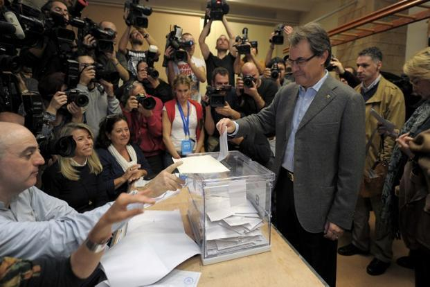 President of Catalonia Artur Mas, right, casts his ballot for regional elections in Barcelona on Sunday. Photo: Lluis Gene/AFP