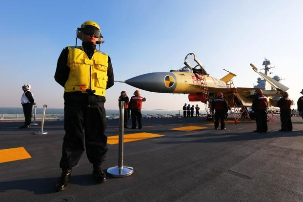 The J-15 is a Chinese designed multi-purpose carrier-borne fighter jet based on Russia's Sukoi 33, equipped with Russian engines and capable of carrying precision-guided bombs. Photo: Reuters/Xinhua/Zha Chunming