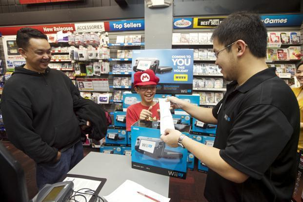 A consumer purchasing Nintendo's Wii U system in Seattle on Friday. Photo: Stephen Brashear/Invision for Nintendo/AP