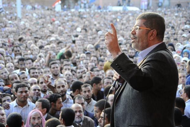 Egyptian President Mohamed Morsi speaks to supporters outside the presidential palace in Cairo. Photo: AP