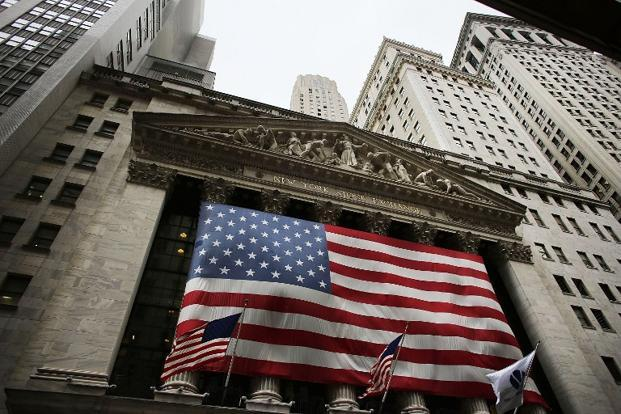 The Dow Jones industrial average was down 74.45 points, or 0.57%, at 12,935.23. The S&P's 500 Index was down 6.50 points, or 0.46%, at 1,402.65. The Nasdaq Composite Index was up 2.10 points, or 0.07%, at 2,968.96. Photo: AFP