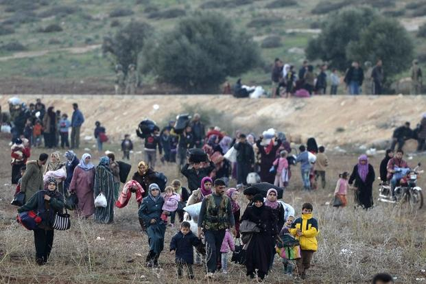 A Syrian warplane bombarded the village of Atme in the northwest of the country near the Turkish border causing hundreds of panicked residents to flee. Photo: Francisco Leon/AFP.
