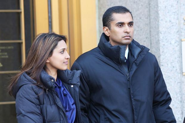 Mathew Martoma exits a New York federal court with his wife. Photo: Spencer Platt/Getty Images/AFP