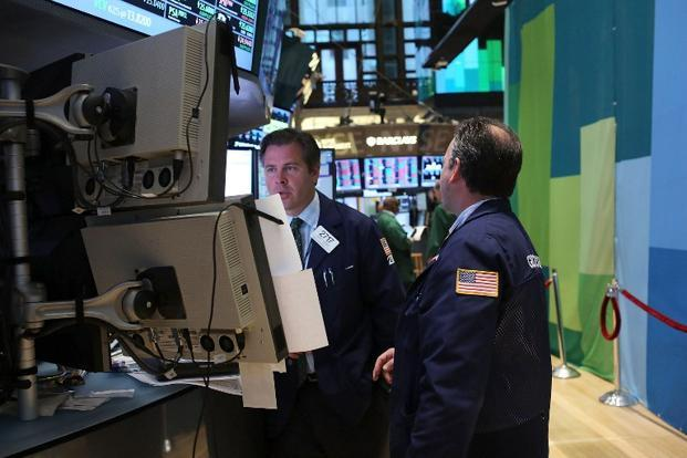 The Dow Jones industrial average fell 42.31 points, or 0.33%, to 12,967.37. The S&P 500 dropped 2.86 points, or 0.20%, to 1,406.29. Photo: Getty Images/AFP