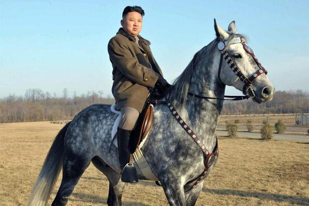 The 'People's Daily' website published a Kim spread—which showed him riding horses, shaking soldiers' hands, clapping, waving. Photo: AFP