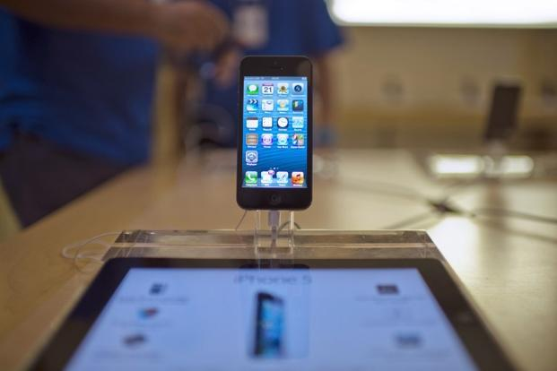 The long wait caused Apple's smartphone market share in China to halve to 10% in the second quarter as users switch brands or hold out for the latest model. Photo: AFP