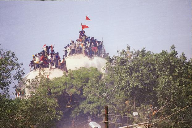 Kar Sevaks on top of the Babri Masjid in 1992. Photo: India Today Group