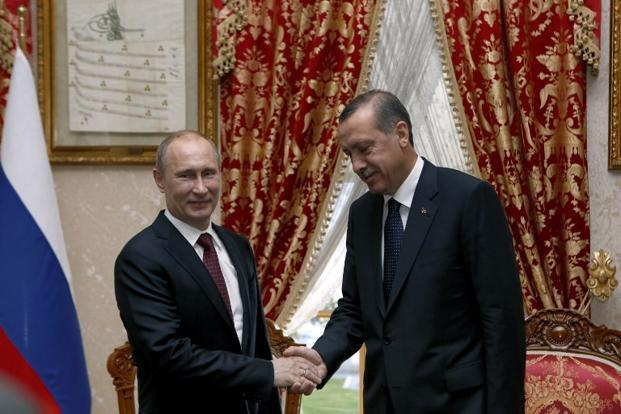 Turkey's Prime Minister Recep Tayyip Erdogan (right) shakes hands with Russia's President Vladimir Putin in Istanbul. Putin arrived in Istanbul for a landmark visit. Photo: Tolga Bozoglu/AFP