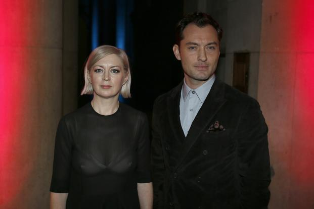 Artist Elizabeth Price (left) poses for a photograph with actor Jude Law after winning Britain's Turner Prize at Tate Britain in London. Photo: Stefan Wermuth/Reuters