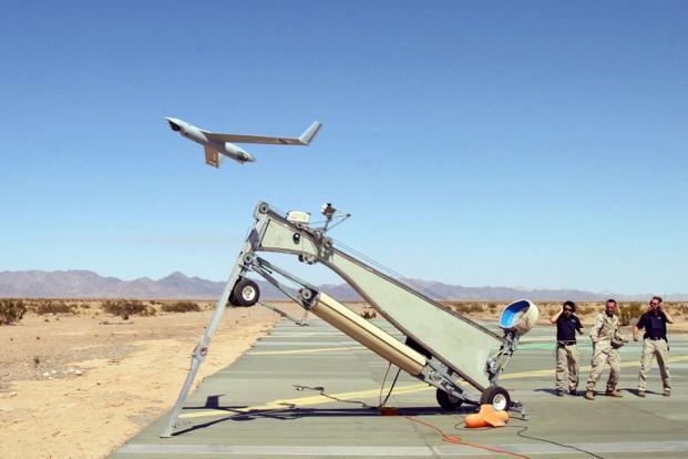 This picture released by the US defense department shows US Marine Corps launching a Boeing ScanEagle during a training exercise. Iran's Revolutionary claimed to have 'captured' a small US drone over Gulf waters. Photo: Sgt Guadalupe M. Deanda/AFP