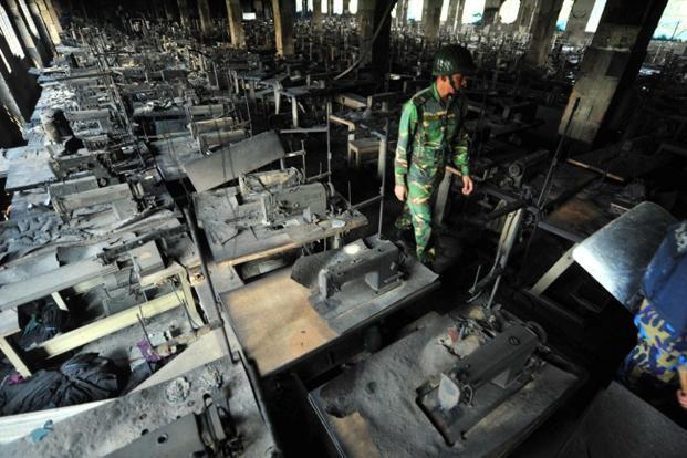 A file photo of a Bangladeshi army personel at the Tazreen Fashions plant. Photo: AFP