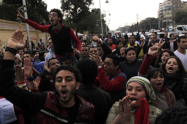 Anti-Mursi protesters shout during a protest against the president outside the presidential palace in Cairo on Wednesday. Photo: Reuters