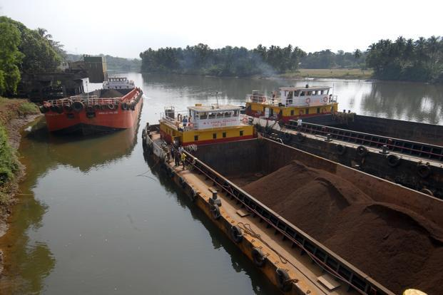 A file photo of iron ore being loaded on a barge in Goa. The project is a relief for Mormugao port after a ban on iron ore mining in Goa crimped export of the commodity through the port since September. Photo: Abhijit Bhatlekar/Mint