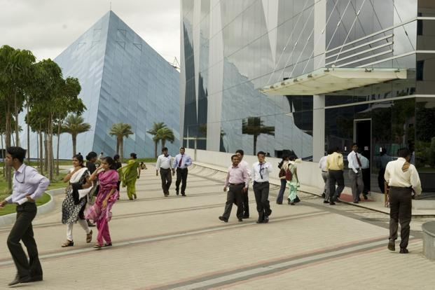 A file photo of Infosys campus in Bangalore. On its part, the tech firm is pushing aggressively to win fresh business, even if it comes at a lower profit margin—a big departure from the past. Photo: Mint
