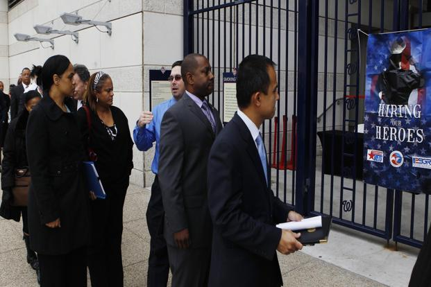 Job seekers line up outside a job fair in Washington. Photo: Reuters