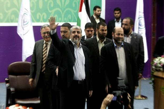 Hamas chief-in-exile Khaled Meshaal (centre) waves at supporters during a visit to the Islamic University in Gaza City on Sunday. Photo: Mahmud Hams/AFP