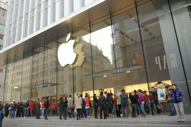 Apple recently began offering songs and movies for download through iTunes. Photo: AFP